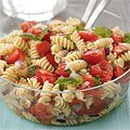 Tomato-Basil Pasta Salad  3 large (about 1 1/2 lb) ripe tomatoes, coarsely chopped (3 1/2 cups) 1/3 cup(s) chopped red onion 1/4 cup(s) extra-virgin olive oil 2 tablespoon(s) red wine vinegar 1 teaspoon(s) minced garlic 1/2 teaspoon(s) each salt and pepper 1/4 teaspoon(s) dried oregano 12 ounce(s) fusilli pasta (or your favorite pasta) 1 cup(s) fresh basil leaves, cut into thin strips