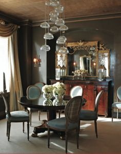 """'Within these walls, the limited palette of golds, silvers, and blues provides a great ambience for any mood you desire.' -""""Elegant Rooms That Work"""", Dining Rooms"""