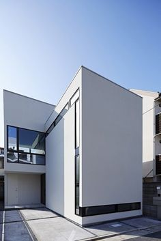 House in Nishiikebukuro is a minimalist house located in Tokyo, Japan, designed by PANDA. The white monolith exterior is contrasted with a warm, well-lit interior focused around privacy and abundant natural lighting. (4)