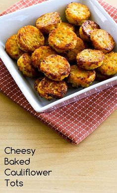 Cheesy Baked Cauliflower Tots (Low-Carb, Gluten-Free) ~ Bite-sized and delicious, these Cheesy Baked Cauliflower Tots are great for a snack or a low-carb side dish! ~ Makes 24 small Cauliflower Tots Paleo Recipes, Low Carb Recipes, Cooking Recipes, Kitchen Recipes, Veggie Dishes, Vegetable Recipes, Side Dishes, Veggie Food, Baked Cauliflower