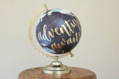 hand lettered calligraphy globe // adventure awaits