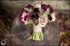 """This bouquet is nearly perfect- but I don't want roses. I really like the different shades of mute purple, the """"springy things- maybe they are vines? And the little ivory accents are nice, too."""