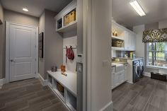 Build your laundry room right off your mud room to minimize mess from dirty sports uniforms, dirt-stained jeans, and more. Seen in FishHawk Preserve, a Tampa community.
