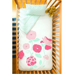 A minty polka dot crib set with a beautiful rose design on top. Handmade in Canada by Atelier ëdele