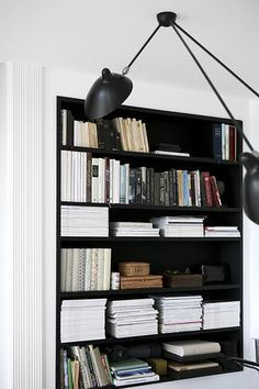 black shelves against white walls