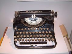 Old typewriters; reminiscent of Jack Kerouac sitting alone in a room somewhere on a desolate road...
