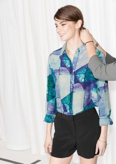 Luscious silk shapes this classic straight-fit shirt featuring a concealed button fastening and pointed collar.