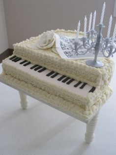 White Baby Grand Piano Cake, Butter cream icing, gum paste flower and music, fondant keys.