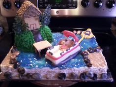 """My daughters friend requested a cake with the stuff she loves to do which is go to the lake and go tubing...so this is what I came up with. """"A day at the lake cake"""""""