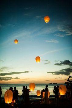 Boho beach wedding lantern release at sunset