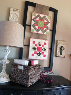 "Carried Away Quilting's projects on the ""Holiday Wishes"" quilt along with Fat Quarter Shop and Sheri Falls.  Mini quilts hung on burlap and window frame. (Moda fabric: Fig Tree, Brenda Riddle, and Sweetwater.)"