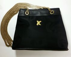 Paloma Picasso Italy. Signed by Paloma Picasso. Black Leather with Gold Tone Chain Handbag. Shoulder Purse. This bag is made of great quality black leather&vinyl and is embellished with gold chain hardware. | eBay!