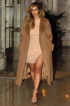 Celeb mom style: Find out where you can get Kim Kardashian's cool camel coat -- as well as one just like it at a fraction of the price.