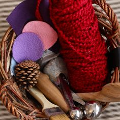 sensory basket for babies    ideas:  -pastry brush  -metal measuring spoons  -pebbles (large enough to not cause a choking hazard)  -wooden spoon  -small whisk  -pieces of felt and other fabrics  -satin ribbon  -pinecone  -sachet of lavender  -sealed bottles or jars of seeds or beans  -salt & pepper shaker with vanilla pods or coffee beans  -feathers  -ball of knitting wool
