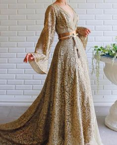 Apr 2020 - Details - Beige and Gold Color - Sparkling lace fabric - Leather belt detail - V-neck gown with long sleeves - For special occasions Pretty Outfits, Pretty Dresses, Fantasy Gowns, Evening Dresses, Prom Dresses, V Neck Wedding Dress, Royal Dresses, Queen Outfit, Beautiful Gowns
