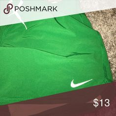 Green Nike shorts Shorts in great shape. Built in spanx are bright yellow. Barely worn. Nike Shorts