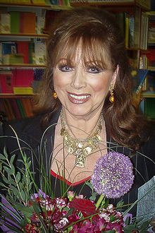 """Jacqueline Jill """"Jackie"""" Collins OBE (4 October 1937 – 19 September 2015) was a British American romance novelist who moved to Los Angeles in the 1960s, where she lived, became a U.S. citizen and wrote most of her novels.[1][2] She wrote 32 novels, all of which appeared on The New York Times bestsellers list. In total, her books have sold over 500 million copies and have been translated into 40 languages.[3][4] Eight of her novels have been adapted for the screen, either as films or television m"""