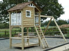 This Miniature Manors play area has a section under the play house which the children use as a cafe.