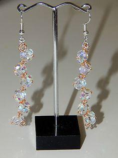 originales boucles d'oreilles en perles de verre blanc et rocailles saumon €4.05