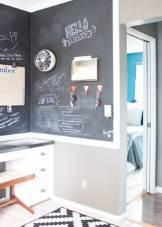 Desk nook in kitchen. Ali and Duffy put in this chalkboard wall themselves. Desk stool from Semi Goods; key hooks from Scout Regalia; SR wall hook; bubble clock from Newgate; brass mail holder from CB2.