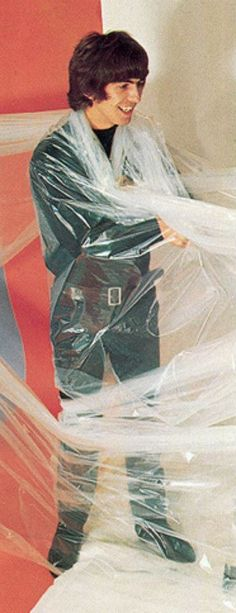 Why is he covered in plastic wrap...? Honestly, I love some of the weird photoshoots the boys had.
