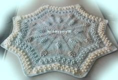 Star Popcorn baby Blanket  pattern is $3. but I think with the right colours, it could be used in a beach/ocean theme nursery.