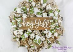 """This wreath screams spring/summer! Based on a 16"""" wireframe, it is loaded with natural & white burlap ribbon along with green and beige cotton wired ribbon. Centered is the 5.5x12 wood sign greeting your guests. Cotton bolls adorn the wreath to add that extra texture and pop!   Shop this product here: http://spreesy.com/whirlwindwhimsy/3   Shop all of our products at http://spreesy.com/whirlwindwhimsy      Pinterest selling powered by Spreesy.com"""