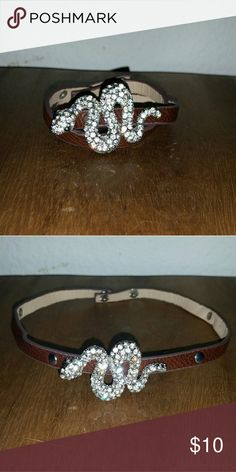 Crystal filled snake charm leather choker bracelet Cute snake charm bracelet / necklace choker with brown leather and snap closure. New, never worn. Approximately 16 inches long. Cam be worn as choker necklace or wrapped twice for cute bracelet cuff style. Jewelry Bracelets