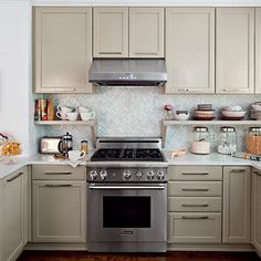 Undercabinet open shelving space created by moving cabinets up to ceiling
