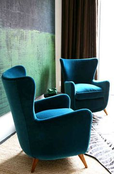Cool Retro armchairs in this season's velvet teal coloured fabric! Super Stylish