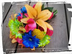 Bright Bridal Bouquet lime green and royal blue gerbera daisy's, orange hybrid lily's, and hot pink roses