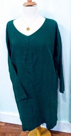 """BEST PRICE! WAS $88    Forest green, long-sleeved knee-legnth tunic dresswith pockets and scoop neck, the comfort and wearibility makes this dress a stylish choice for your wardrobe.    Add a gold plated Zen necklace for more panache! (was $25)    Derived from the latin word meaning """"most useful,"""" the flax plant is a highly sustainable resource with fibers that make durable, soft and very easy-to-wear clothing. Touted for the style and comfort, Flax garments are also known to be…"""