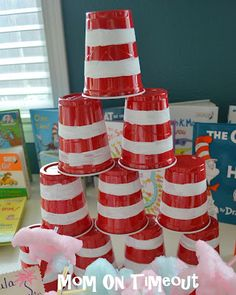For cat in the hat party paint white stripes on red solo cups.for natalie's 2nd bday party