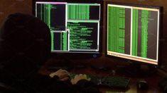 Criminal hacker with black hood penetrating network system from his dark hacker room. Criminal hacker with black hood penetrating network system from his dark hacke by Footage Autor Mafia, Cyberpunk, Technology Photos, Black Hood, Character Aesthetic, Computer Science, Coding, Dark, Alaska