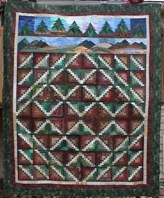 Black Hills Log Cabin by Libby Phillips. The Log Cabin block variation is from Scraps, Blocks & Qults by Judy Martin. Libby added trees (also designed by Judy) from Quilter's Newsletter and mountains (of Libby's own design??). Perfect!