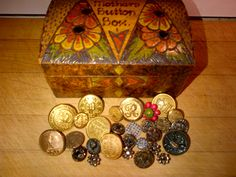 Antique and collectible buttons and a vintage button box.