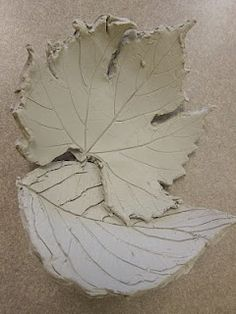 "Clay leaves - good way to teach about rolling slabs. First, roll out a slab of clay, then place a leaf onto the clay. Roll over it with a rolling pin to make an impression. Then trace around it with a knife & cut out the clay leaf. Peel the leaf off & use a toothpick to make deeper indentations ("",)"