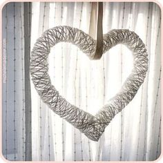 Great DIY~ ♥ HEART ♥ Made from a Balloon (the kind that can be animals) and yarn or twine. You can hang it as shown, or leave a little more space between and add crafts for a wreath. It you make it with twine support it to make a topiary. :)