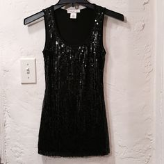 """Arden B Black Sequin Tank Top (Size XS) Women's size XS black sequined tank top made by Arden B. Back of the tank top has NO sequins (only on the front), and top isn't missing sequins and has no """"bald patches""""... Perfect condition, super cute on and stretchy! 95% rayon and 5% spandex. Would fit a size 4-6 comfortably. Arden B Tops Tank Tops"""