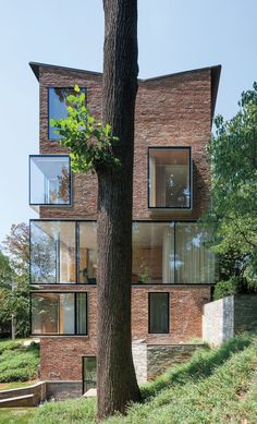 NADAAA Masterfully Renovates 1920's House With Simple Plywood Very interesting treatment of windows