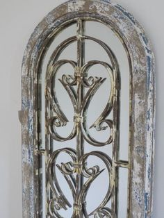 Beautiful, Rustic Style Door Mirror. Made from wood, this is a gorgeous Gothic style Curved Door with a distressed finish and mirror inset. Scrolled metal detai