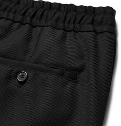 Both comfortable and smart, <a href='http://www.mrporter.com/mens/Designers/AMI'>AMI</a>'s drawstring trousers are cut from virgin wool-twill in a relaxed slim-fit shape. Wear yours on casual work days, with either sneakers or simple Derbies.