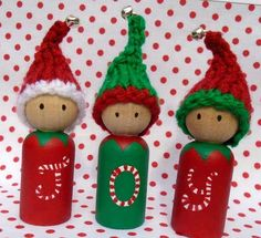 Christmas Peggies .... A set of 3 Christmas Peg dolls meet the Peggie trio Joy Hand painted with a sprinkle of Christmas magic! from their heads to their little toes. Finished off with a cute little hand knitted Christmas hat with a teeny tiny jingly bell! Christmas Peggies Approx 9 cm high from their little elf toes to the top of their jingly hats. Hand painted with non toxic Acrylic paints then sealed with a Satin UV varnish. Decorated in traditional Christmas colours red & holly gr...