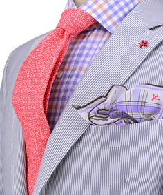 I'm a fan of salmon and coral. It works nicely with lavender, and the tightness of the pinstripes overcomes the pattern conflict.