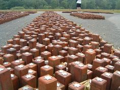 An image of a monument at former Nazi camp Westerbork in the Netherlands. Each stone represents a single person who had stayed at Westerbork and died in a Nazi camp. Anne Frank stayed here from August till early September 1944, before she was taken to Auschwitz.