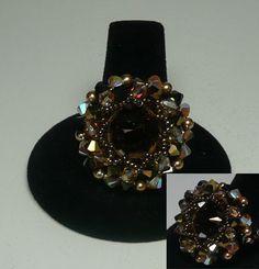 Volare Bronze  Design by Lilie Poupette   Swarovski Bronze Rivoli with Smoke Topaz, Dorado 2X, Golden Shadow, Sand Opal AB2X, Jet Nut bicones with Bronze pearls with fire polished and miyuki beads