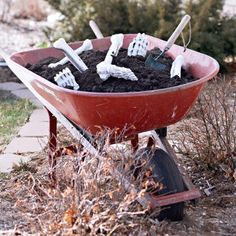 Buy a skeleton, but rather than hanging it up, have some parts stick out of a mound of dirt either on the ground (maybe in a fresh grave) or in a wheelbarrow near the front porch. It will really scare kids if they happen to bump into it when they are getting candy.