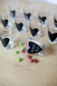 DIY your own wedding favors using chalkboard and shot glasses. Everyone loves souvenir shot glasses & can't beat the price point!