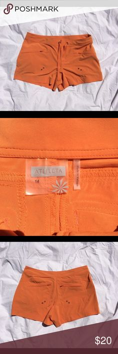 """NWOT athleta shorts orange size 14 Orange shorts in amazing condition new without tags! Size 14  measurements:  39"""" waist  13"""" length  4"""" inseam   #101 Athleta Shorts"""
