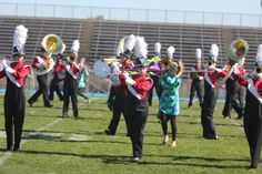 """Marching band receives Division I at State"" via Tiger Hi-Line, Oct. 17, 2013"